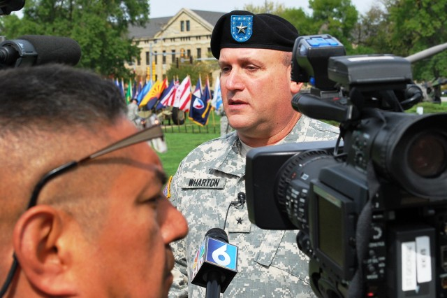 Brig. Gen. John F. Wharton answers questions from the Quad Cities media after the ceremony. (Photo by Jon Connor, ASC Public Affairs)