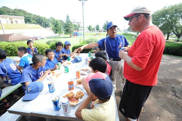 Players and their family had a picnic lunch at Dewey Park in Camp Zama after the game.