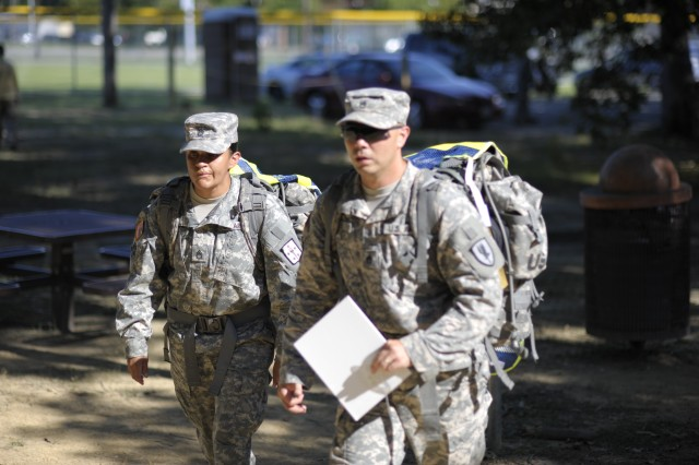 Sgt. 1st Class Brenda Andrade of Fort Lee, Va., and Staff Sgt. Phillip Lee of Fort Rucker, Ala. march to locate one of many warrior tasks during the 2011 Platoon Sergeant of the Year Competition at Fort Eustis, Va.