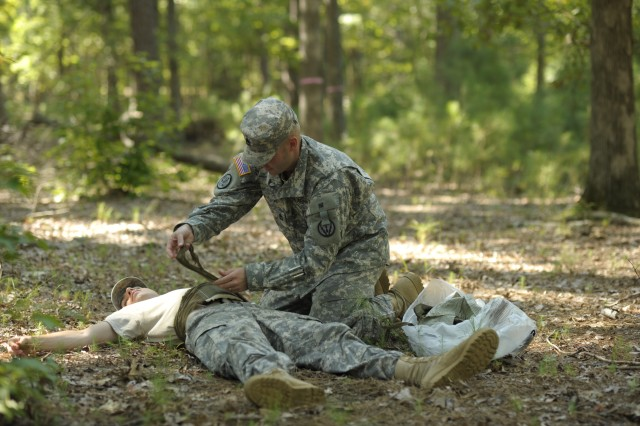 Sgt. 1st Class Paul Gahl of Fort Sill, Okla., provides medical treatment during warrior task rotations at the 2011 Platoon Sergeant of the Year Competition at Fort Eustis, Va. Gahl won last year's competition and performs special assignments as the PSOY while assigned to Initial Military Training Center of Excellence, U.S. Army Training and Doctrine Command.