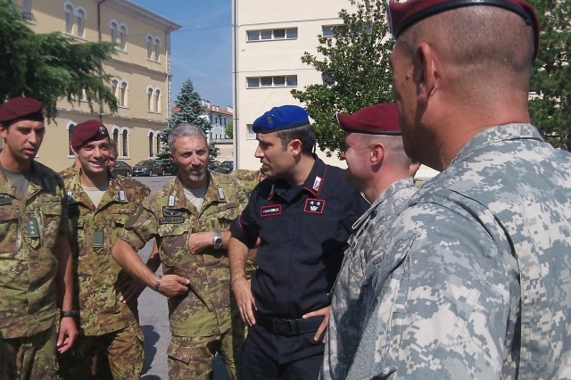 Members of the local Italian carabinieri talk with Soldiers from the rear detachment of U.S. Army Europe's 173rd Airborne Brigade Combat Team about their deployment experiences during a cross-cultural awareness and information operations training session at the carabinieri compound in Vicenza, Italy, Sept. 11.
