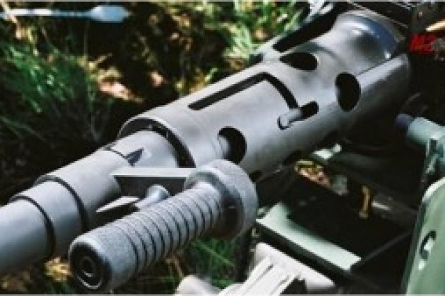 The M2A1 is an enhancement to the .50-Cal M2, including a modified barrel, barrel extension, barrel support, barrel handle, flash suppressor and a fixed headspace and timing configuration. The M2A1 is an automatic, recoil-operated, link-belt-fed, air-cooled, crew-served weapon; capable of firing single-shot and automatic; and capable of right- and left-hand feed. The enhancements increase durability and Soldier safety moving the headspace and timing adjustment task above the operator level, thereby minimizing malfunctions and injuries in the field.