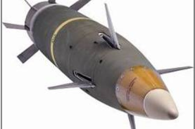 A GPS-guided, inertial measurement unit-aided, fin-stabilized, 155mm projectile flies a ballistic trajectory during its ascending branch, then a guided trajectory during its descending branch to preprogrammed target coordinates. It provides precision guidance and dramatically improves accuracy to less than 10 meters compared with hundreds of meters for conventional artillery ammunition. This increased reliability increases the probability of destroying the target and decreases the number of rounds needed to fire. The range capability increases from 25.3 kilometers to 37.5 kilometers.
