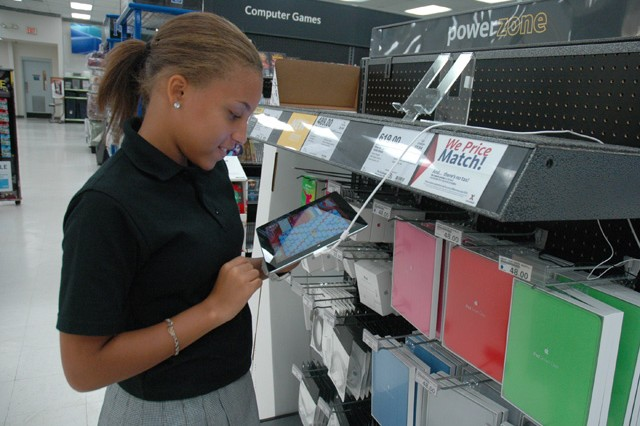Tona Raimpell, 14, views an iPad on display while shopping at the APG Exchange.  Electronics like iPads, flat screen televisions and Blu-ray players are top-sellers at the APG Exchange.