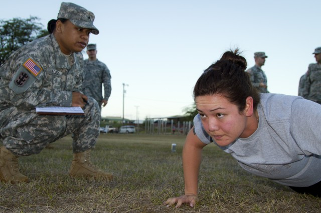 Sgt. Rebecca Holland paralegal NCO for the 8th Theater Sustainment Command, 8th Military police battalion knocks out pushups during the paralegal warrior competition physical fitness test on fort shafter flats August 30, 2012.