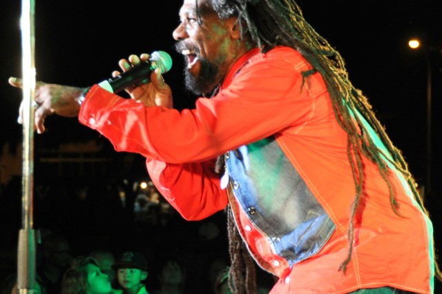 Dave McAnuff, lead singer of reggae collective Macka Ruffin and Macka Roots, sings for the crowd, Sept. 15, 2012.
