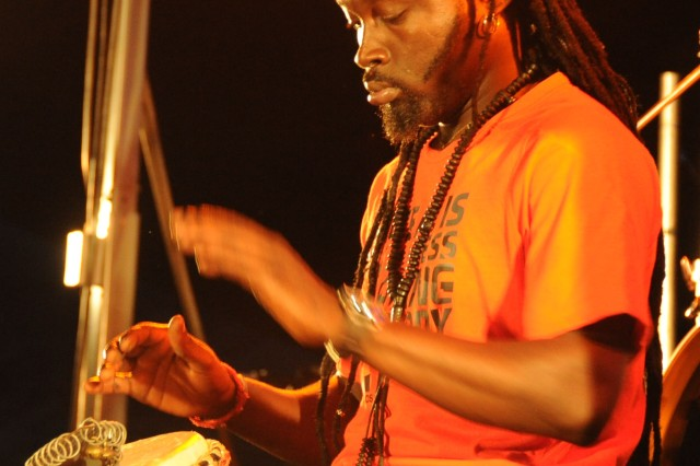 Omar Gaindefall, percussionist for the reggae collective Macka Ruffin and Macka Roots, plays a djembe drum onstage, Sept. 15, 2012, at Music Fest.