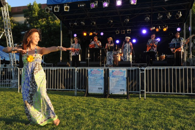 Rae Balidoy dances the hula while Hawaiian band Island of da Heart plays onstage on the first day of Camp Zama's Music Fest.