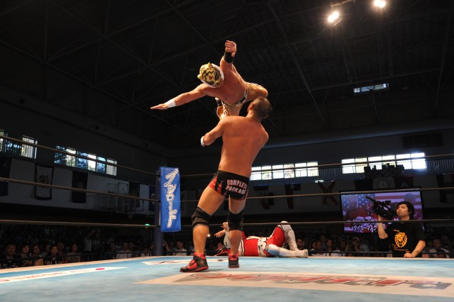 Tiger Mask takes a flying leap at his opponent Gedo during a tag team match at Camp Zama's Slam Fest.