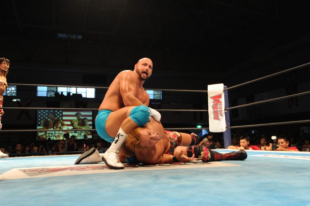 "Karl ""Machine Gun"" Anderson attempts to get his opponent Kazuchika Okada during the three-on-three tage team match that served as the finale for Camp Zama's Slam Fest VI wrestling event, held Sept. 16, 2012, at Yano Fitness Center on Camp Zama, Japan."