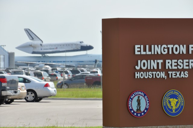 The Space Shuttle Endeavour is shown in Houston, Sept. 19, 2012. The retired spacecraft made a brief stop at the city's Ellington International Airport before being flown to Los Angeles, where it will be permanently displayed at a museum complex there. The airport is adjacent to Ellington Field Joint Reserve Base, and troops from many of the units stationed there were on hand for the orbiter's arrival.