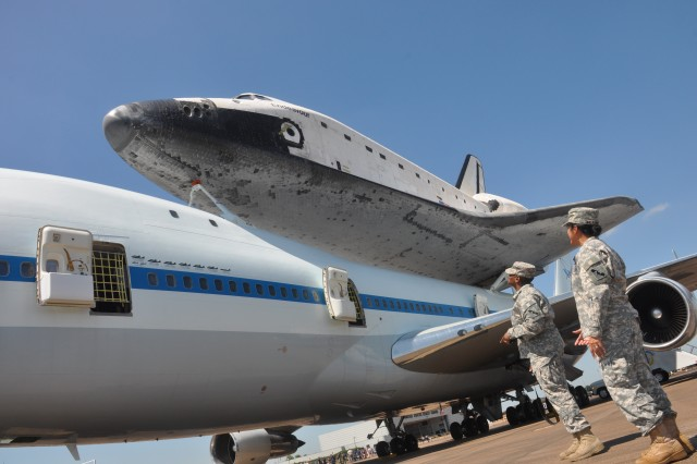 Lt. Col. Ana Malkowski and Capt. Ashlei Brooks, with the 75th Training Command, observe the Space Shuttle Endeavour in Houston, Sept. 19, 2012. The retired spacecraft made a brief stop at the city's Ellington International Airport before being transported to a museum complex in Los Angeles. The 75th is headquartered at the adjacent Ellington Field Joint Reserve Base, and is the senior military headquarters in Houston.