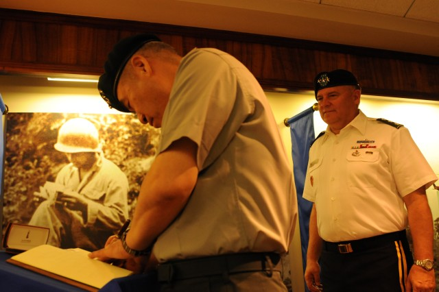 Gen. Oh Sung Kwon, Deputy Commander of the Republic of Korea-U.S. Combined Forces Command and the Ground Component Commander signs the Richardson Hall guest book Sept. 19 after his arrival to U.S. Army Pacific Headquarters. Lt. Gen. Francis Wiercinski, USARPAC commander (looking on) welcomed Kwon, alongside members of the USARPAC staff, during an Honor ceremony held at Historic Palm Circle on Fort Shafter, Hawaii.