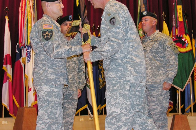 Col. John G. Norris (L) receives the guidon from Maj. Gen. James C. Boozer, Sr., U.S. Army Europe Deputy Commanding General, assuming command of the Joint Multinational Readiness Center at Hohenfels, Sept. 19.