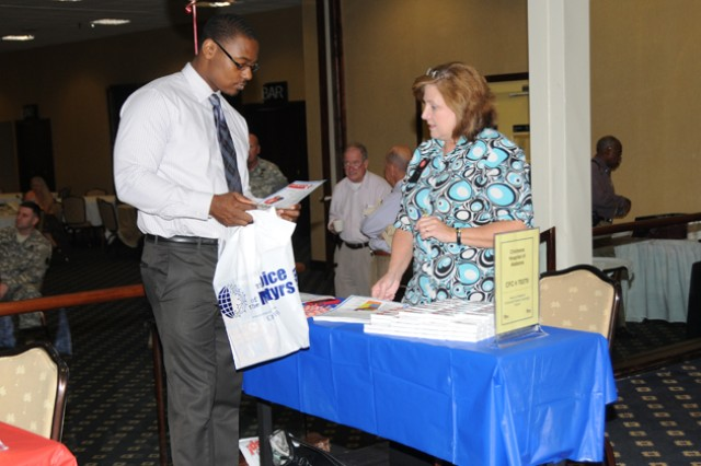 Jarkayzio Frank, Directorate of Human Resources employee, talks with Angie Sherrill, southeast Alabama Children's of Alabama coordinator, to get more information on the organization during the Combined Federal Campaign kickoff event Sept. 17. Children's of Alabama is one of the many organizations in the CFC campaign, which collectively hopes to raise $1.15 million on Fort Rucker.