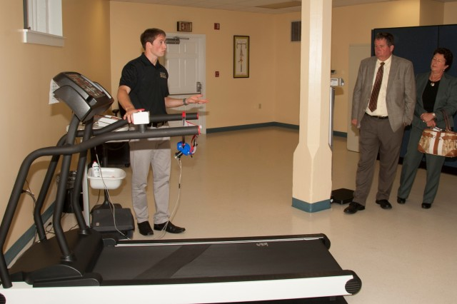 An employee at the Carlisle Barracks Army Wellness Center demonstrates the features of a treadmill. (Photo courtesy U.S. Army War College)