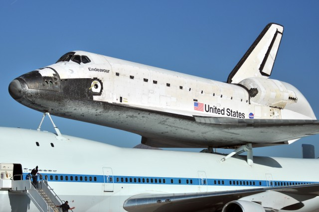 NASA's Space Shuttle Endeavour, perched atop a modified Boeing 747-100 airliner, lands at the Departure/Arrival Airfield Control Group at Biggs Army Airfield, Texas, Sept. 20, 2012. The Endeavour has been decommsioned and was making its way across country to Edwards Air Foce Base, before moving to its permanent retirement home at the California Science Center in Los Angeles.