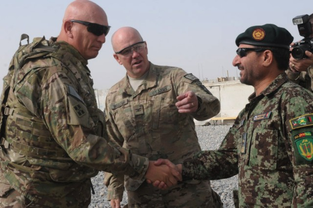 Chief of Staff of the Army Gen. Raymond T. Odierno is greeted by Afghan National Army Brig. Gen. Ahman Habibi, commander of 1st Kandak, 205th Hero Corp at Forward Operating Base Zangabad, Afghanistan, Sept. 18, 2012.  Odierno's stop at the FOB was part of a Regional Command (South) visit where he focused on gathering first-hand information from Soldiers on the ground about counter improvised explosive device measures, Security Force Assistance Teams, Afghan National Security Forces progress and inside-the-wire threats, among other topics.