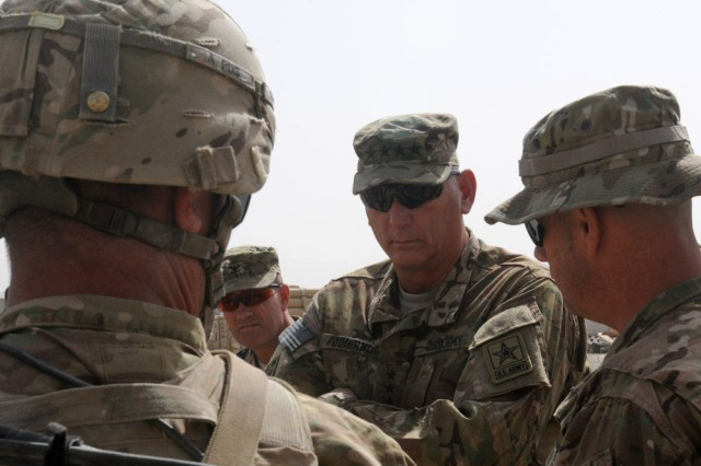 Chief of Staff of the Army Gen. Raymond T. Odierno listens to a counter improvised explosives device brief from 3rd Stryker Brigade, 2nd Infantry Division Soldiers at Forward Operating Base Zangabad, Afghanistan, Sept. 18, 2012.  Odierno's stop at the FOB was part of a Regional Command (South) visit where he focused on gathering first-hand information from Soldiers on the ground about counter improvised explosive device measures, Security Force Assistance Teams, Afghan National Security Forces progress and inside-the-wire threats, among other topics.