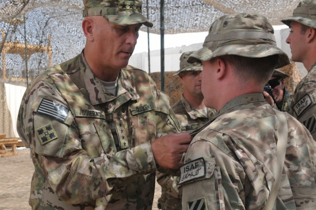 Chief of Staff of the Army Gen. Raymond T. Odierno pins an Army Commendation medal onto a Soldier from the 3rd Infantry Division at Forward Operating Base Zangabad, Afghanistan, Sept. 18, 2012. Odierno's stop at the FOB was part of a Regional Command (South) visit where he focused on gathering first-hand information from Soldiers on the ground about counter improvised explosive device measures, Security Force Assistance Teams, Afghan National Security Forces progress and inside-the-wire threats, among other topics.