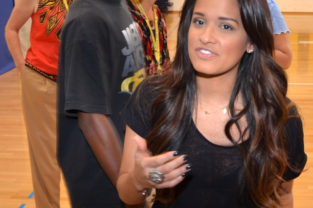 Rocsi Diaz, host of BET's flagship hip hop and R&B video variety show 106 & Park, talks with Vicenza High School students about self-esteem, bullying and protecting one's identity and reputation on social media during a visit to the school on Caserma Ederle Sept. 10.