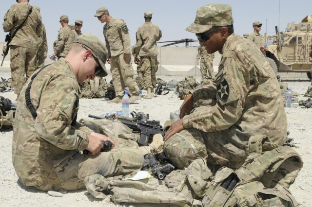 Pfc. Nicholas Cravillion and Pfc. Deomi Tulloc, members of Alpha Company, 5th Battalion, 20th Infantry Regiment, conduct inspections of their gear at Forward Operating Base Spin Boldak prior to an Operation Southern Strike III air assault somewhere in the district of Spin Boldak, Kandahar province, Afghanistan, Aug. 31, 2012.