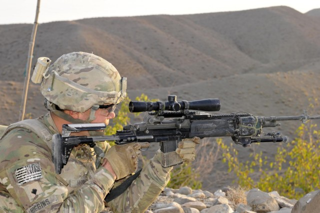 Spc. Jared Higgins, an infantryman with Headquarters and Headquarters Company, 5th Battalion, 20th Infantry Regiment, scans his sector with an M14 Enhanced Battle Rifle during Operation Southern Strike III in the district of Spin Boldak, Kandahar province, Afghanistan, Sept. 2, 2012.