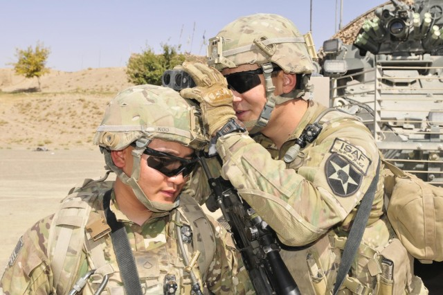 From left, Pfc. David Koo of Atlanta, Ga., and Spc. Jared Higgins of Eustis, Fla., work together as a team after dismounting a Stryker fighting vehicle during Operation Southern Strike III in the district of Spin Boldak, Kandahar province, Afghanistan, Sept. 2, 2012. Both infantrymen are with Headquarters Company, 5th Battalion, 20th Infantry Regiment, 2nd Infantry Division.