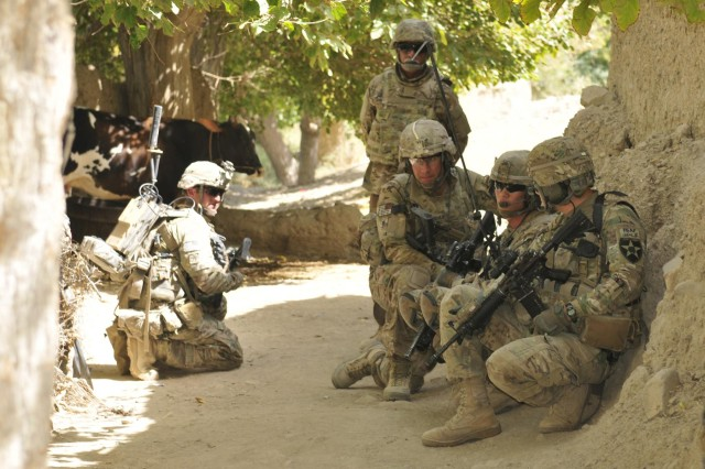 Lt. Col. Steven Soika (third from right) and Soldiers with Headquarters Company, 5th Battalion, 20th Infantry Regiment, stop while on a patrol during Operation Southern Strike III in the district of Spin Boldak, Kandahar province, Afghanistan, Sept. 2, 2012. The 5-20th Infantry is part of the 3rd Stryker Brigade Combat Team, 2nd Infantry Division. Soika's hometown is Brunswick, Ohio.