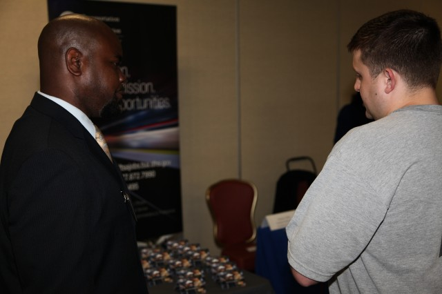 Recruiters for receptive employers meet with eager military applicants to discuss job opportunities at the Hiring Heroes Career Fair at the Sam Houston Club. The job fair is designed to match specefic employment needs with a diverse and well trained military member transition to civilian life.