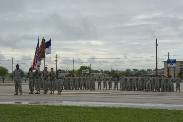 Students and cadre of the Fort Hood Air Assault School class 003-12 stand at parade rest during the graduation ceremony on Sadowski Field Monday. Eighty-seven troops graduated from the course Sept. 17.