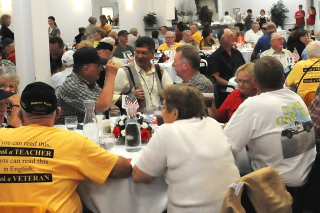 Ninety World War II and Korean War veterans, along with 37 Gold Star family members, mingle before dinner Sept. 19 at the Davenport, Iowa, Hy-Vee banquet hall on East Kimberly Road. (Photo by Capt. Johnathon Knapton, ASC Public Affairs)