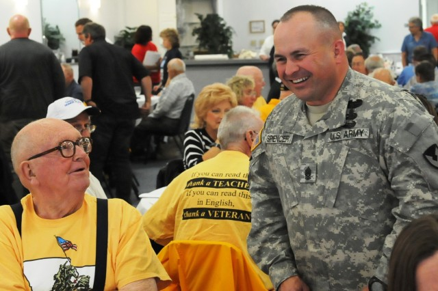 Command Sgt. Maj. James Spencer, Army Sustainment Command, shares a laugh with a veteran. (Photo by Johnathon Knapton, ASC Public Affairs)