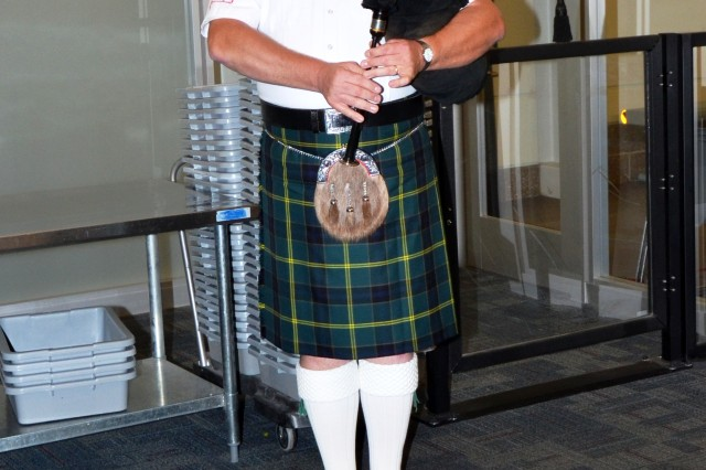 Bagpiper Derek Grant plays a tune as the veterans arrived at the Quad City International Airport around 10 pm. Sept. 20. Grant is a familiar face at the airport as he plays at all the returning honor flights. (Photo by Galen Putnam, ASC Public Affairs)