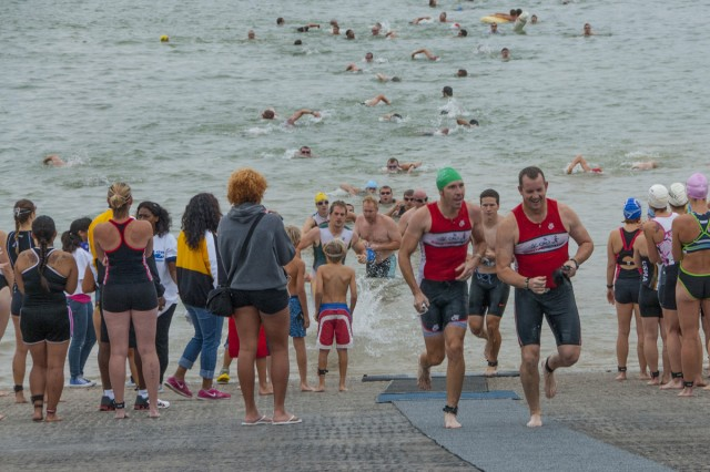 The male group of the Sprint Triathlon emerges from the water and makes their way toward their bikes to begin the second stage of the event at BLORA Sept 15..