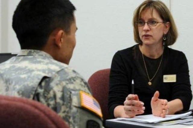 Lori Mann, right, a counselor with the Army Career and Alumni Program, offers career guidance to a  Soldier at the ACAP center on Joint Base Lewis-McChord, Wash., earlier this year. ACAP has been redesigned as part of a new interagency Transition Assistance Program for service members.