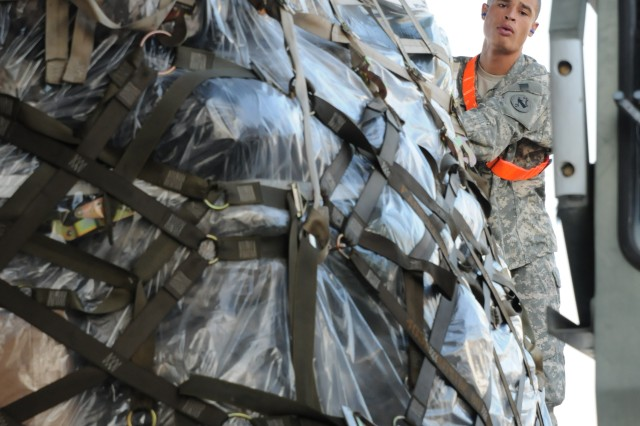 Pfc. Antonie Easley, Operations Co., U.S. Army Pacific, loads a pallet of gear onto a C-17 bound for Talia Military Camp, Tonga. Soldiers with the U.S. Army Pacific Contingency Command Post (CCP), 311th Signal Command and 25th Infantry Division boarded the plane soon after on their way to support Operation Coral Reef, a week-long humanitarian exercise.