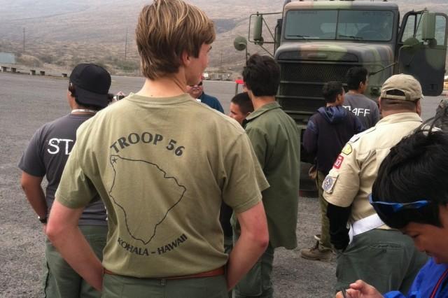 Boy Scouts gathering around M916 truck trailer.