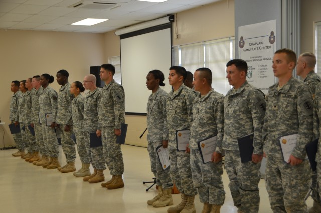 Soldiers of 643rd receive Certificate of Achievement Awards for their efforts during the Chaplain Family Life Center window construction.