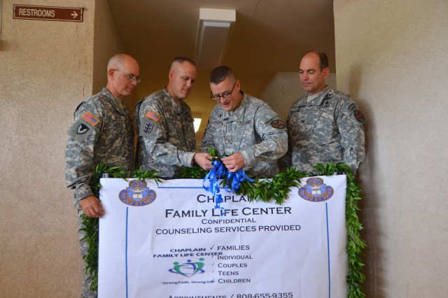 From Left to Right Garrison Chaplain Col. Pete Mueller, Chaplain Maj. Kelly Porter, Chaplain Maj. Chris Wilson, and Garrison Commander Col. Daniel Whitney cut the ceremonious ribbon, opening the new Chaplain Family Life Center