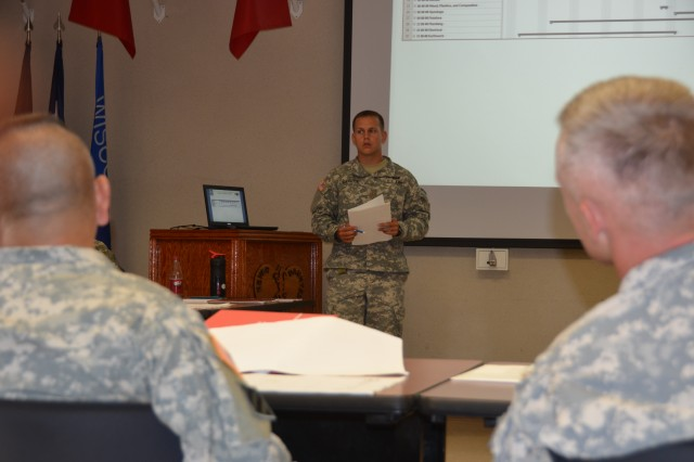 2nd Lt. Andrew Karwick explains his level two gantt chart during his Construction Leader Certification Brief to the 84TH Battalion Commander Lt. Col. Aaron Reisinger and Command Sgt. Maj. Joe Constante.