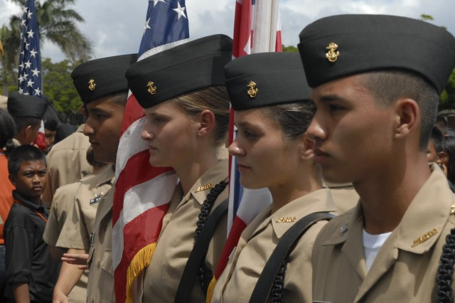 Cadet Seamen Apprentice Denali Jackson (second from left) and the rest of her drill team from Kalaheo High School, pause their routine during the Junior Reserve Officer Training Corps competition at Hickam Air Force Base, and hosted by the Sergeant Audie Murphy Clubs of Hawaii, the 25th Infantry Division, and Tripler Army Medical Center.