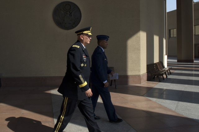 U.S. Army Chief of Staff Gen. Raymond T. Odierno exits the U.S. Embassy in Cairo, Egypt after meeting the U.S. Ambassador to Egypt Sept. 20, 2012.  Odierno is accompanied Air Force Maj. Gen. Richard Clarke, Defense Attaché in Egypt.  (U.S. Army Photo by Staff Sgt. Teddy Wade/Released)