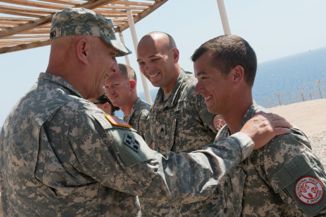 U.S. Army Chief of Staff Gen. Raymond T. Odierno laughs with Soldiers as he awards coins for excellence during a visit to South Camp near Sharm el Sheikh, Egypt Sept. 21, 2012. The Soldiers are deployed in the Sinai Peninsula in support of the Multinational Force and Observers. The MFO is an international peacekeeping force overseeing the terms of the peace treaty between Egypt and Israel. The MFO is currently comprised of troop formations from 12 different nations. (U.S. Army Photo by Staff Sgt. Teddy Wade/Released)