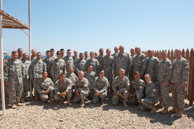 U.S. Army Chief of Staff Gen. Raymond T. Odierno poses for a group photo with Soldiers at South Camp near Sharm el Sheikh, Egypt after an award ceremony Sept. 21, 2012. Soldiers are deployed in the Sinai Peninsula in support of the Multinational Force and Observers. The MFO is an international peacekeeping force overseeing the terms of the peace treaty between Egypt and Israel. The MFO is currently comprised of troop formations from 12 different nations. (U.S. Army Photo by Staff Sgt. Teddy Wade/Released)