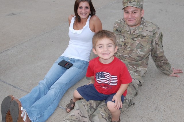 Sgt. Eric Anzur, from Monaca, Penn. and the battalion paralegal for 3rd Battalion, 187th Infantry Regiment, 3rd Brigade Combat Team, 101st Airborne Division, sits and relaxes with his wife and son before deploying from Fort Campbell, Ky. to Afghanistan Sept. 2012 in support of Operation Enduring Freedom. Before departing, the Soldiers also listened to their leaders speak about the importance of the unit's combat mission. (U.S. Army photo taken by Sgt. Alan Graziano, 3rd Brigade Combat Team, 101st Airborne Division)