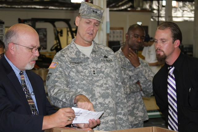Mr. Donald Olson, left, shares the shipping documentation with Maj. Gen. John O'Connor, from a tri-con that came to Sierra Army Depot from the W7A yard.