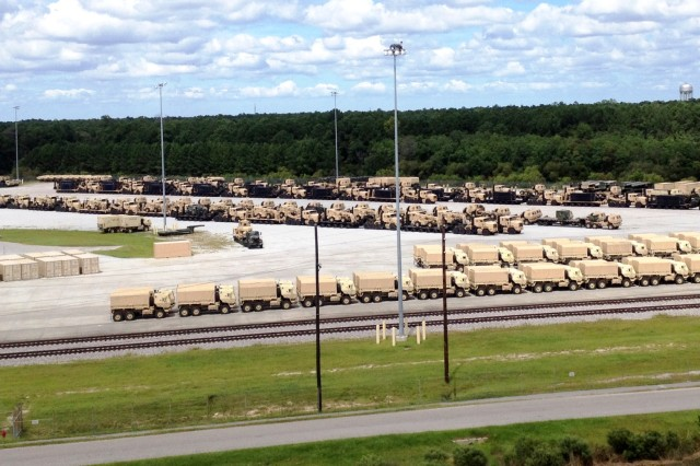 These vehicles are staged for transport to be placed aboard the U.S. Naval Ship Watson at Wharf Alpha, Joint Base Charleston, S.C. The Watson set sail Sept. 22. (Photo by Lee Hansen, Army Sustainment Command)