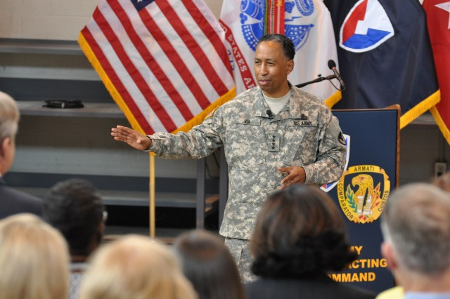 Gen. Dennis L. Via, Army Materiel Command commanding general, answered questions during a Sept. 25 town hall meeting with members of the Army Contracting Command and Expeditionary Contracting Command. Via discussed the importance of contracting during his visit with the staffs.