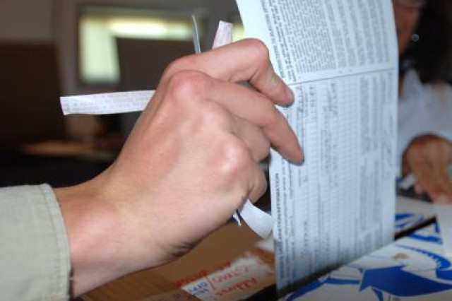 A service member overseas casts a federal write-in absentee ballot in a prior election.